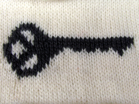 knitted swatch of key motif 